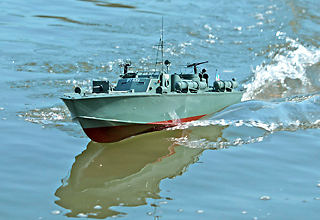 an rc pt boat at speed