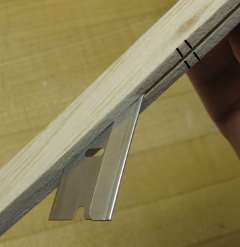 separating two duplicate balsa parts with a razor blade