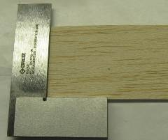 cut a straight edge at the end of a sheet of balsa