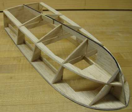 rc boat hull framed and partially sanded
