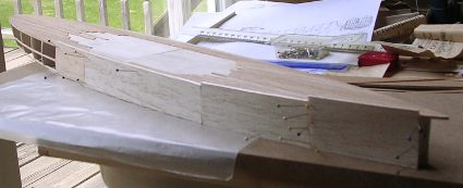 hull planking of 1/16 inch balsa sheet started photo
