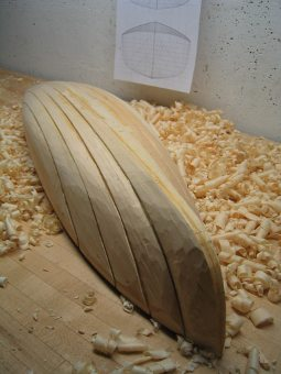 model boat in the carving process