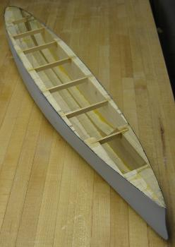 laminated model boat hull after carving